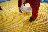 pic of convection  - group of workers installing underfloor heating and colling in modern home - JPG