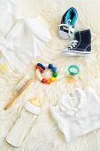 image of teething baby  - Collection of items for babies shot from above - JPG