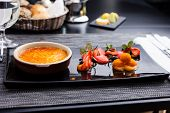 stock photo of sea-buckthorn  - Creme brulee with strawberry foam and sea buckthorn sorbet - JPG