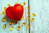 pic of cod  - Red heart and cod liver oil on blue wooden background - JPG