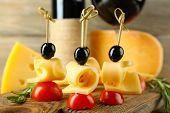 image of canapes  - Cheese canapes with wine on table close up - JPG
