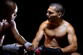 foto of pep talk  - Trainer motivating a muscular Boxer or MMA fighter with pep talks - JPG