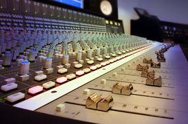 stock photo of recording studio  - a modern recording studio mixing console  close up - JPG
