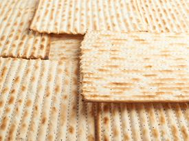 stock photo of piety  - Surface covered with machine made matza flatbread as a background texture - JPG