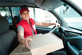 foto of packages  - Colorful picture of courier delivers package - JPG