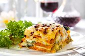 stock photo of vegetarian meal  - Vegetarian lasagne topped with toasted pine nuts and melting cheeses - JPG