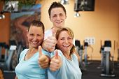 Gym Employees Holding Thumbs Up
