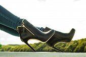 Постер, плакат: Woman Legs In Denim Pants Heels Shoes Outdoor