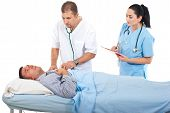 Physician Assess Sick Patient In Hospital