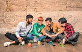 Постер, плакат: Group Of Hipster Best Friends With Smartphones In Grungy Alternative Location Young Entrepreneurs