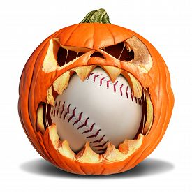 stock photo of softball  - Autumn baseball concept as a pumpkin jack o lantern biting into a leather softball as a symbol for halloween sports and fall sporting events on a white background - JPG