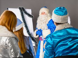 foto of conduction  - santa claus is conducting a business training - JPG