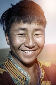 stock photo of mongolian  - Mongolian Man Traditional Dress Solitude Tranquil Concept - JPG
