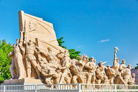 stock photo of struggle  - Commemorating statues of workers in struggle in the revolution of China located near mausoleum of Mao Zedong Beijing - JPG