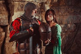 picture of sword  - Old King with the sword is leaving his princess - JPG
