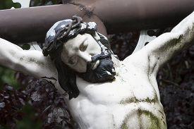 stock photo of crucifixion  - The crucifixion of Jesus Christ on a cemetery - JPG