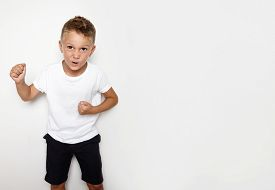 stock photo of hooligan  - Mockup of young hooligan showing some angry emotion on the white background - JPG