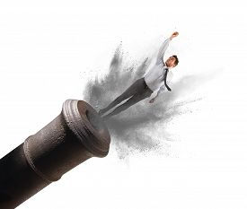 stock photo of cannon  - Businessman shot from a cannon with power - JPG