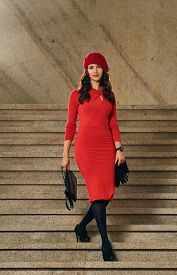 stock photo of beret  - Portrait full length of a beautiful young woman with background stairs outdoors - JPG