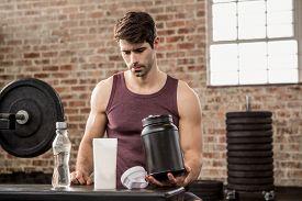 pic of tin man  - Man holding supplement tin at the gym - JPG