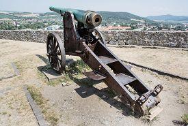 stock photo of cannon  - Rusty historic cannon in Trencin castle Slovak republic - JPG