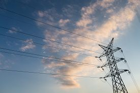 foto of electricity pylon  - A long line of electrical transmission towers  - JPG