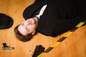stock photo of corpses  - Corpse of business man lays on a floor - JPG