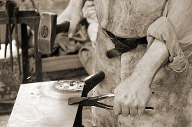 stock photo of blacksmith shop  - blacksmith at work in the repair shop in italy - JPG
