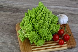 pic of romanesco  - Romanesco exotic cabbage on the wood background - JPG