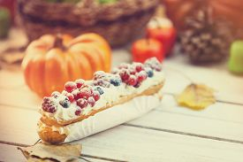 image of eclairs  - Eclair apple pumpkin and other on wooden table - JPG