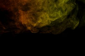stock photo of hookah  - Abstract art. Colorful red and green smoke hookah on a black background. Background for Halloween. Texture fog. Design element. The concept of toxic substances.