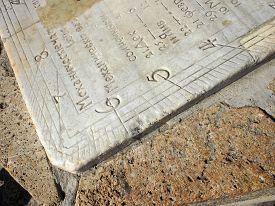 foto of slab  - Detail of old sundial clock face closeup - JPG