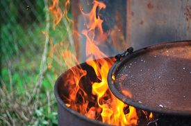 stock photo of leak  - A fire flames leaking out of the barrel - JPG