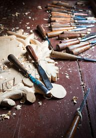 stock photo of woodcarving  - Tools of the woodcarver on wood table background - JPG