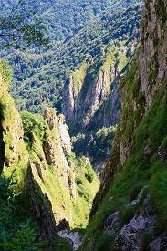 image of ravines  - Deep ravine along a trekking path Italian alps - JPG
