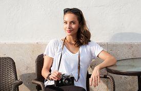 stock photo of analogy  - Gorgeous young brunette woman using analog camera - JPG
