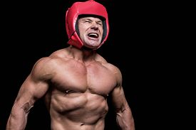 picture of headgear  - Angry boxer with red headgear against black background - JPG