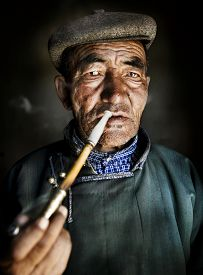 picture of mongolian  - Mongolian Traditional Dress Smoking Pipe Solitude Concept - JPG