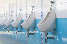 stock photo of urinate  - Urinal is a row in public toilet - JPG