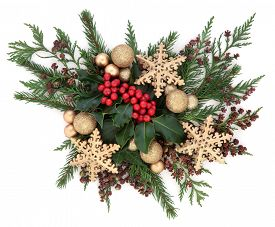 stock photo of greenery  - Christmas flora with gold bauble and star decorations with holly - JPG