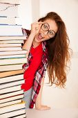 Attractive Beautiful Woman Geek In Study With Pile Of Books poster