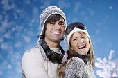 stock photo of late 20s  - couple in their late 20s in ski hats and glasses - JPG