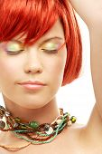 stock photo of carnal  - picture of green beads redhead with eyes closed - JPG