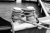 Постер, плакат: Cleat On The Stern Of A Boat With A White Rope