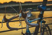 Cycling In Sunset. Lifestyle Concept. Hipster Cycling In Sunset In Countryside. Healthy Lifestyle. P poster