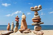 Several Rock Zen Pyramids Of Colorful Pebbles On A Beach On The Background Of The Sea. Concept Of Ba poster