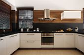 Elegant White And Black Kitchen With Wooden Accents And Silver Oven And Sink poster