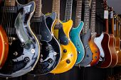 Row Of Electric Guitars In A Music Instruments Shop. Parts Of Guitar, Guitar Body poster