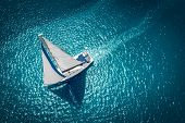 Regatta Sailing Ship Yachts With White Sails At Opened Sea. Aerial View Of Sailboat In Windy Conditi poster
