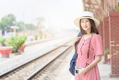 Young Hipster Traveler With Backpack And Vintage Camera At Railway Station, Travel Concept poster
